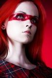 Uma mulher bonita com olhos de gato Fotos de Stock Royalty Free