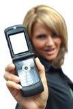 Uma mulher bonita com telefone Fotografia de Stock Royalty Free