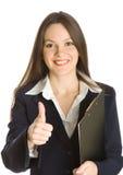 Uma mulher de negócios bonita que prende uma prancheta Fotos de Stock Royalty Free