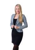 Uma mulher de negócios loura nova na roupa formal imagem de stock royalty free