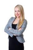 Uma mulher de negócios loura nova na roupa formal fotografia de stock