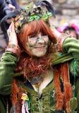 Uma mulher em Jack no festival verde Imagem de Stock