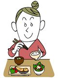 Uma mulher está comendo ilustração stock