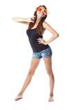 Uma mulher está tendo o divertimento no estúdio Foto de Stock Royalty Free