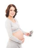 Uma mulher gravida que guarda uma imagem do raio X no branco Imagem de Stock Royalty Free