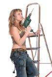 Uma mulher no stepladder Fotos de Stock