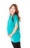 Uma mulher nova de sorriso grávida Fotografia de Stock