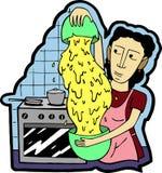 Uma mulher prepara o jantar na cozinha imagem de stock royalty free