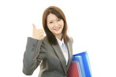 Uma mulher que sorriso feliz Imagem de Stock
