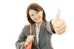 Uma mulher que sorriso feliz Fotografia de Stock