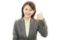 Uma mulher que sorriso feliz Imagens de Stock