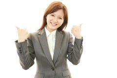 Uma mulher que sorriso feliz Fotos de Stock Royalty Free
