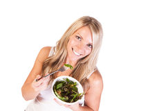 Uma mulher saudável com salada no fundo branco Fotos de Stock Royalty Free
