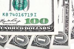 Uma nota de dólar e cem fotos do macro da cédula do dólar Fotografia de Stock
