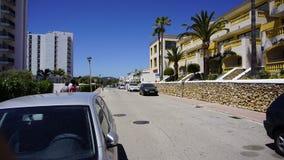Uma opinião o filho Bou do céu azul com as árvores em Minorca Foto de Stock
