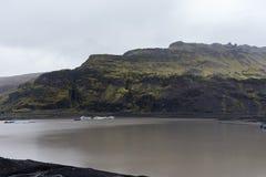 Uma outra vista nos montes perto da geleira do rdalsjökull do ½ de Mà Imagem de Stock