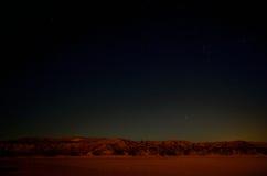 Uma paisagem do deserto na noite Fotografia de Stock Royalty Free
