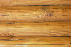 Uma parede da cabana rústica de madeira como um fundo Fotografia de Stock