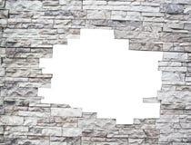 Uma parede de pedra com indicador branco Imagens de Stock Royalty Free