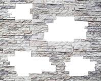 Uma parede de pedra com indicadores brancos Imagens de Stock