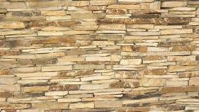 Uma parede de uma pedra decorativa amarela selvagem Fotografia de Stock Royalty Free
