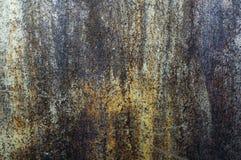 Uma parede velha do metal, oxidada de vez em quando, do ferro fotografia de stock royalty free
