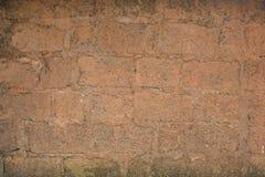 Uma parede velha do vermelho de tijolo Textura áspera masonry foto de stock