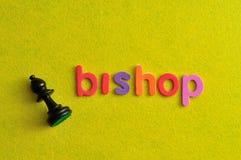 Uma parte de xadrez do bispo com o bispo da palavra Fotos de Stock Royalty Free