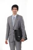 Uma pasta levando do homem de negócios. fotos de stock