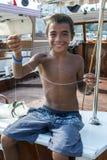 Uma pesca do menino em Roman Harbour em Kaleici em Antalya em Turquia Imagens de Stock