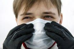 Uma pessoa em uma máscara Foto de Stock