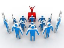 Uma pessoa faz uma comunicação do anúncio a um grupo Imagem de Stock