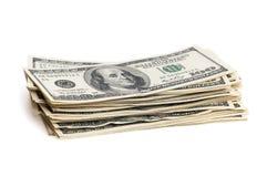Uma pilha de cem notas de dólar em um fundo branco Isolado Imagem de Stock Royalty Free