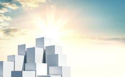 Uma pilha de cubos contra um nascer do sol bonito Fotos de Stock Royalty Free