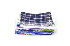 Uma pilha de lenços quadrados Imagens de Stock