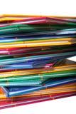 Uma pilha de livros finos coloridos Imagem de Stock