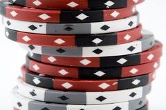 Uma pilha de microplaquetas do póquer Fotografia de Stock Royalty Free