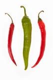 Uma pimentas verde e duas vermelha Fotografia de Stock