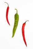 Uma pimentas verde e duas vermelha Foto de Stock Royalty Free