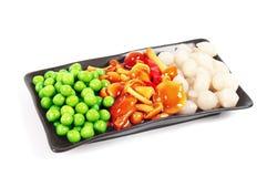 Uma placa das salmouras. Ervilhas, cogumelos e cebolas Imagem de Stock Royalty Free