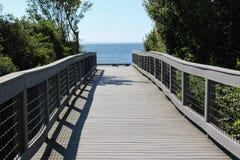 Uma ponte a uma praia Imagem de Stock Royalty Free