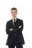 Uma posição bem sucedida de sorriso do homem de negócios Imagem de Stock