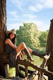 Uma rapariga no estilo do país. Imagens de Stock