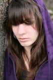 Uma rapariga é triste Foto de Stock