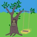 Uma árvore com a família do balanço e da coruja Fotografia de Stock Royalty Free