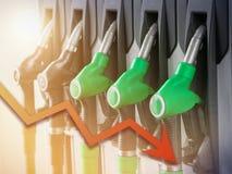 Uma série de distribuidores do combustível na coluna de abastecimento imagem de stock royalty free