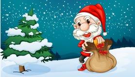Uma Santa curto com um saco de presentes Foto de Stock Royalty Free