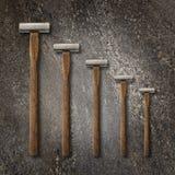 Uma seleção da carpintaria da precisão martela em um contexto de pedra Fotos de Stock Royalty Free