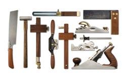 Uma seleção de ferramentas da carpintaria da precisão em um contexto branco Imagens de Stock