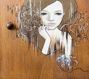 Uma senhora nova e bonita pintada na madeira imagem de stock royalty free